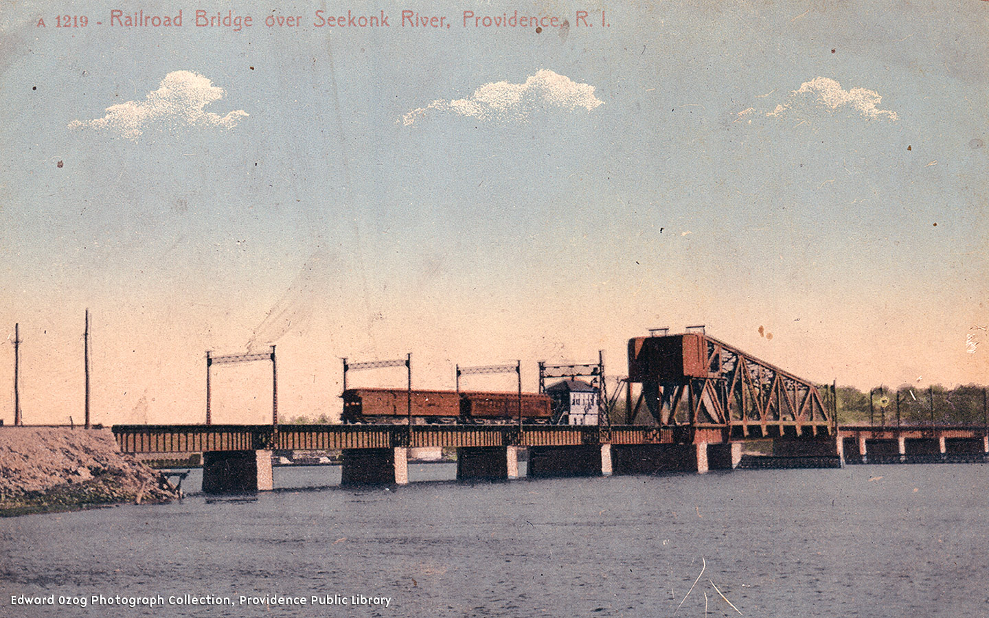 A steel and iron truss lift bridge that is two railroad ties wide and ever since 1976, stuck in the up position to allow boats to pass underneath and they travel up and down the Seekonk river