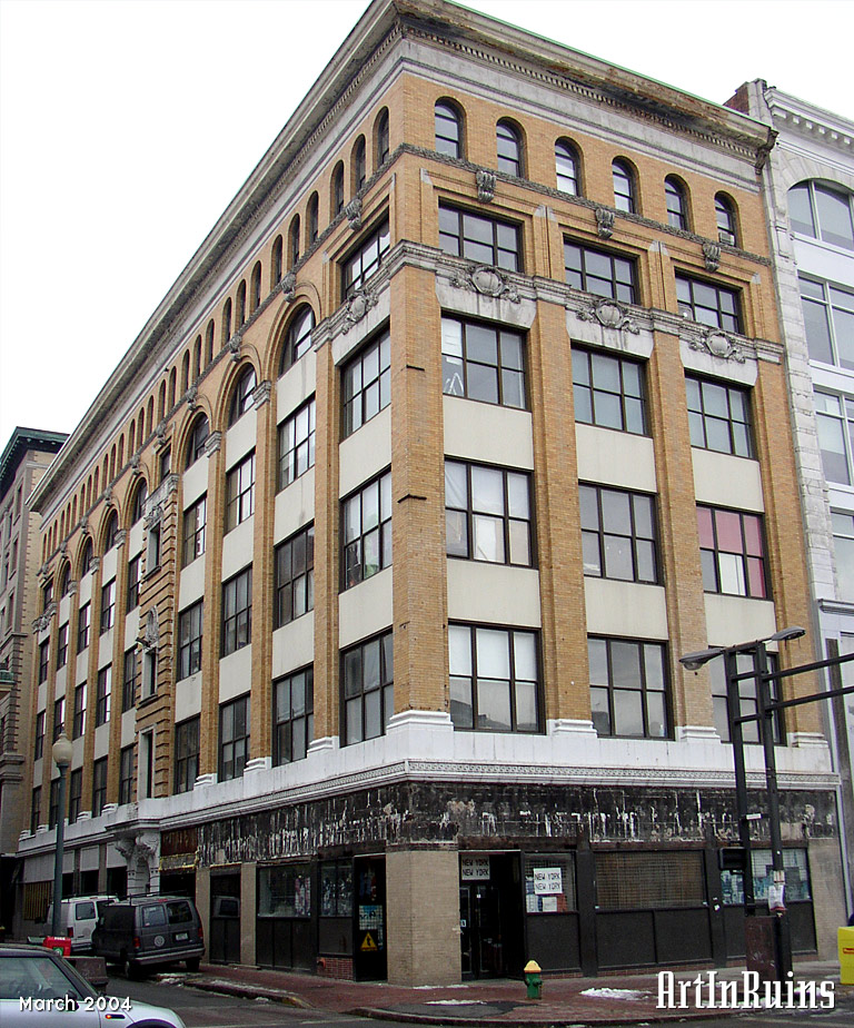 A three bay wide, ten bay deep six story commercial building. The first through fourth story are comprised of square windows, while the fifth story features half moon windows with arched tops, and the sixth story pairs two arched windows to every single window below. An ornate central entrace at 212 Union Street features an arch flanked by twin decorative corbels. The window lintels on the fifth floor feature decorative corinthian-style crests